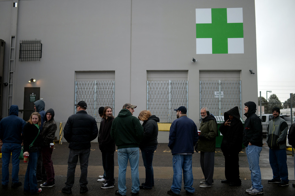 . DENVER, CO. JANUARY 01: People stood in lines for hours to buy legal marijuana at Medicine Man marijuana dispensary on New Years day morning in Denver, Colorado January 1, 2014. Medicine Man marijuana dispensary is one of the stores that was able to begin selling legal recreational-marijuana on January 1st, 2014. (Photo by Hyoung Chang/The Denver Post)