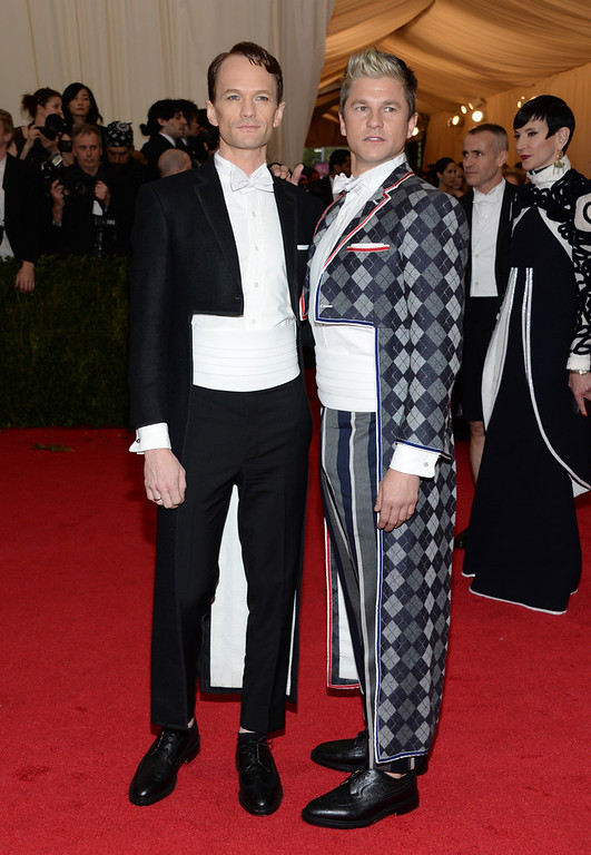 """. Neil Patrick Harris, left, and David Burtka attend The Metropolitan Museum of Art\'s Costume Institute benefit gala celebrating \""""Charles James: Beyond Fashion\"""" on Monday, May 5, 2014, in New York. (Photo by Evan Agostini/Invision/AP)"""