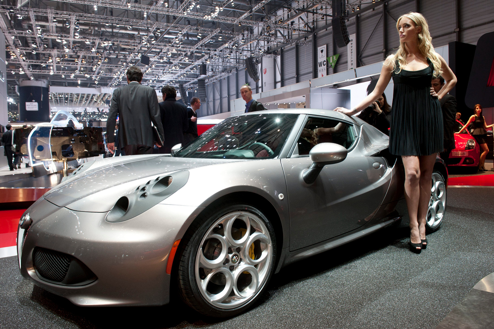 . The new Alfa Romeo 4C is shown during the press day at the 83rd Geneva International Motor Show in Geneva, Switzerland, Tuesday, March 5, 2013. The Motor Show will open its gates to the public from 7th to 17th March presenting more than 260 exhibitors and more than 130 world and European premieres. (AP Photo/Keystone, Sandro Campardo)