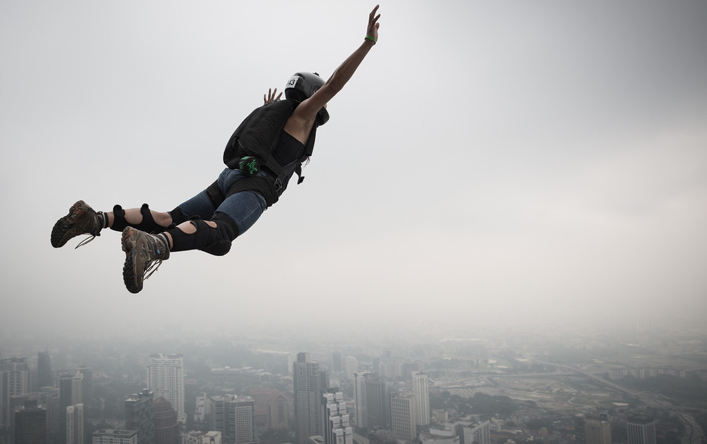 . Base jumper Katherine Donahue from the US leaps from the 300-meters Open Deck of the Malaysia\'s landmark Kuala Lumpur Tower during the International Tower Jump in Kuala Lumpur on September 27, 2013.  AFP PHOTO / MOHD RASFAN/AFP/Getty Images