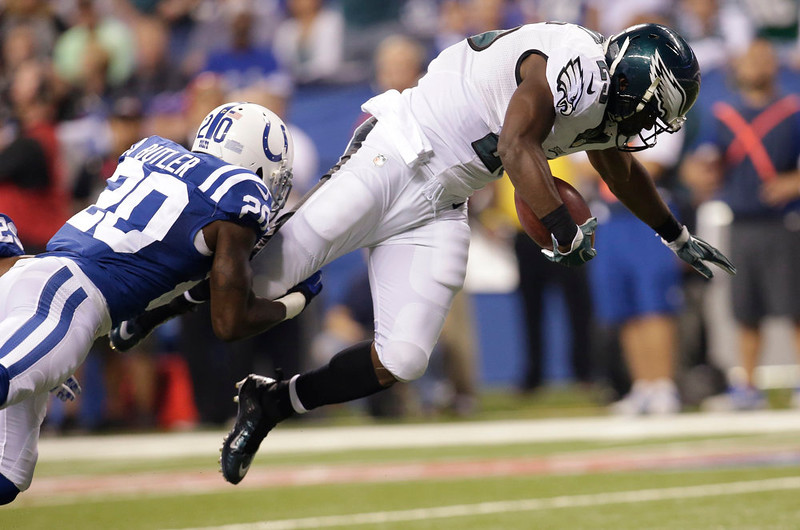 . Philadelphia Eagles running back LeSean McCoy (25) is tackled by Indianapolis Colts free safety Darius Butler (20) during the first half of an NFL football game Monday, Sept. 15, 2014, in Indianapolis. (AP Photo/AJ Mast)