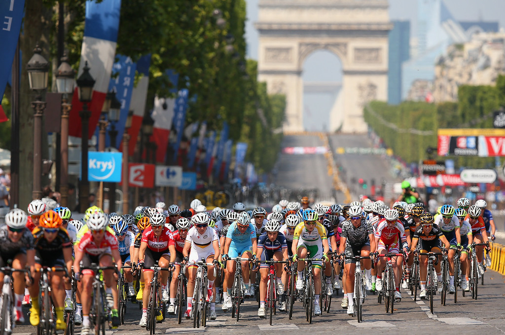 . Riders in action during \'La Course by Le Tour de France\' on July 27, 2014 in Paris, France. In this historic first edition of the event, female professional riders will race 90km on Champs Elysees prior to the arrival of the Men\'s Tour de France final stage.  (Photo by Bryn Lennon/Getty Images)
