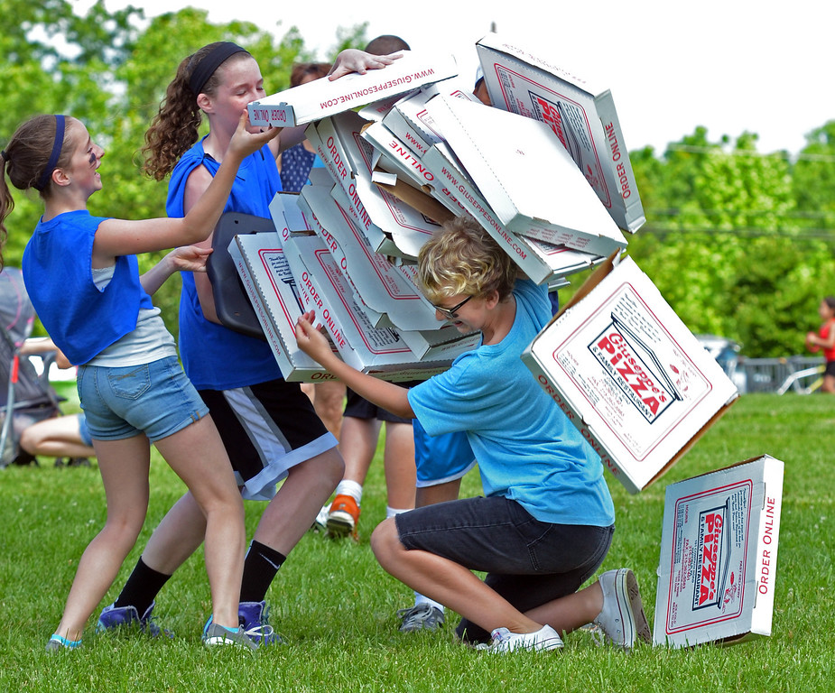 . Boxes tumble as sixth graders compete in the pizza relay during Olympics Day at Hatfield elementary school.   Friday, June 6, 2014.   Photo by Geoff Patton