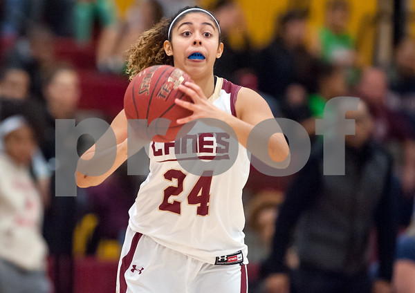 12/29/17 Wesley Bunnell | Staff New Britain basketball was defeated by visiting Wilbur Cross 56-28 on Friday evening at New Britain High School. Savannah Gonzalez (24) looks to pass.