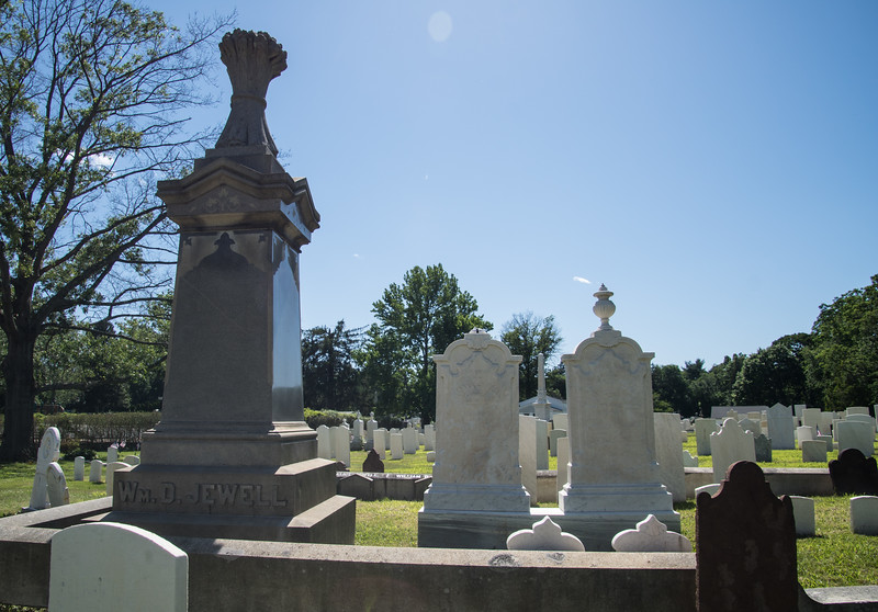 This plot was awash with changes. Older sandstone stones stood pressed with their backs against the granite surround. The grand, ornate marble stones perched in the center, marking inscribed on the granite with the names of each resting place.  Each stone speaking of an earlier age, the last, the tallest and most grand, William, who passed in 1893.
