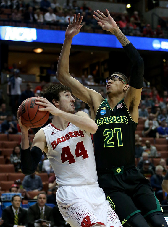 . Frank Kaminsky #44 of the Wisconsin Badgers looks to shoot against Isaiah Austin #21 of the Baylor Bears in the first half during the regional semifinal of the 2014 NCAA Men\'s Basketball Tournament at the Honda Center on March 27, 2014 in Anaheim, California.  (Photo by Jeff Gross/Getty Images)