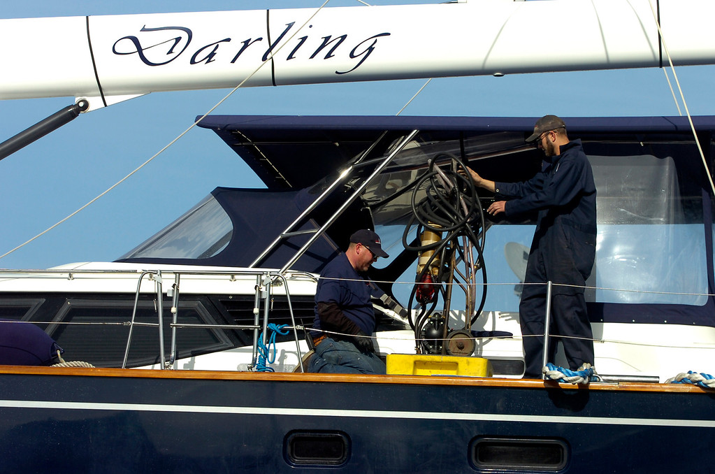 . Two workers are aboard the Darling at the Bay Marine Boatworks yard in Richmond, Calif. on Tuesday, March 5, 2013. The Darling was stolen from a Sausalito marina, then ran aground in Pacifica on Monday. (Kristopher Skinner/Staff)