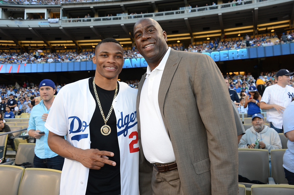 . NBA player Russell Westbrook and Magic Johnson attend a game between the Los Angeles Dodgers and the New York Yankees on July 30, 2013 at Dodger Stadium in Los Angeles, Caifornia. (Photo by Jon Soohoo/Los Angeles Dodgers via Getty Images)