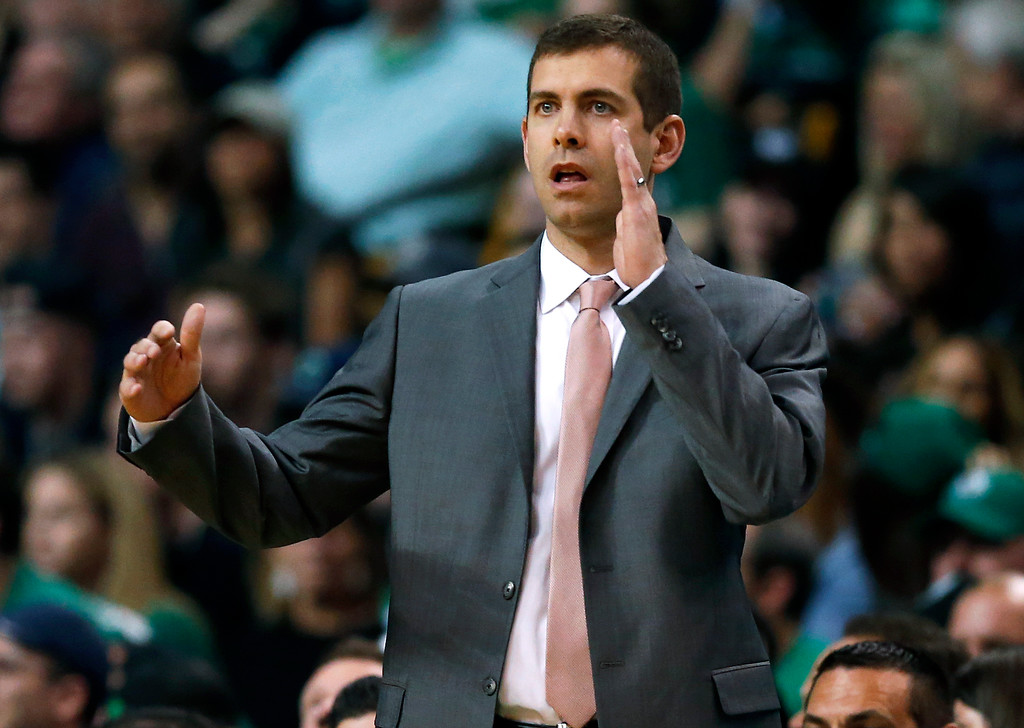 . Boston Celtics head coach Brad Stevens signals from the sideline during the first half in Game 7 of the NBA basketball Eastern Conference finals against the Cleveland Cavaliers, Sunday, May 27, 2018, in Boston. (AP Photo/Elise Amendola)