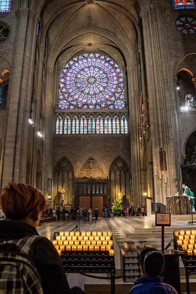 "Services are conducted throughout the day.  This is looking across the transept and altar to the North ""Rose"" window."