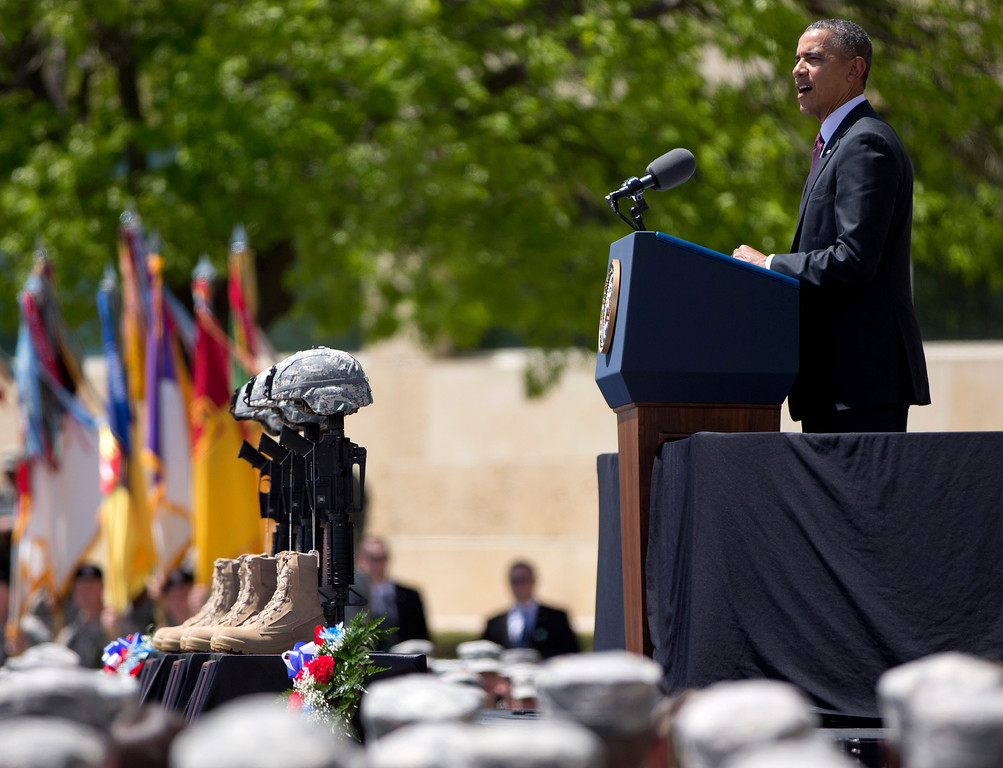 . President Barack Obama speaks during a memorial ceremony, Wednesday, April 9, 2014, at Fort Hood Texas, for those killed there in a shooting last week. President Barack Obama is reprising his role as chief comforter as he returns once again to a grief-stricken corner of America to mourn with the families of those killed last week at Fort Hood and offer solace to the nation. (AP Photo/Carolyn Kaster)