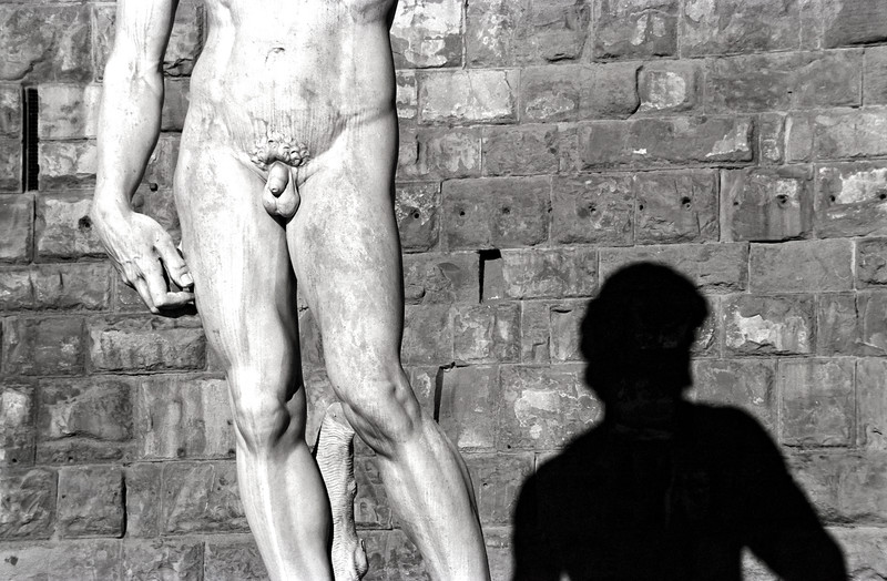 Michelangelo's statue of David casts shadow on the wall,  Piazza della Signoria, Florence, Italy