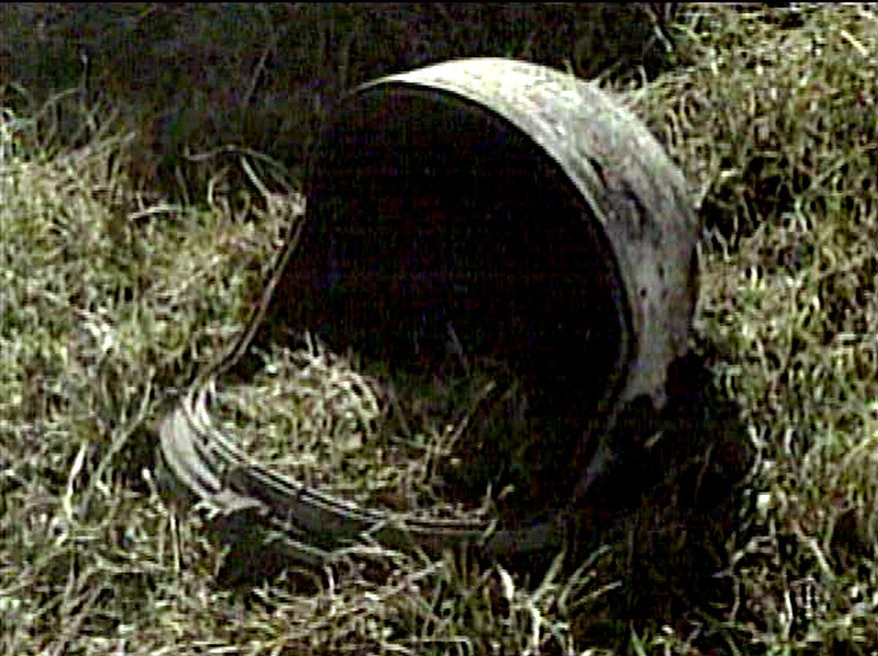 . A helmet from mission STS-107 is seen in this image from television, Sunday, Feb. 2, 2003 in San Augustine, Texas. Remnants of the space shuttle Columbia remained strewn across east Texas and Louisiana Sunday, as authorities probed possible causes for the tragedy that pierced a crystal blue sky and stung deeper into an already shaken sense of security. (AP Photo/KHOU-TV)