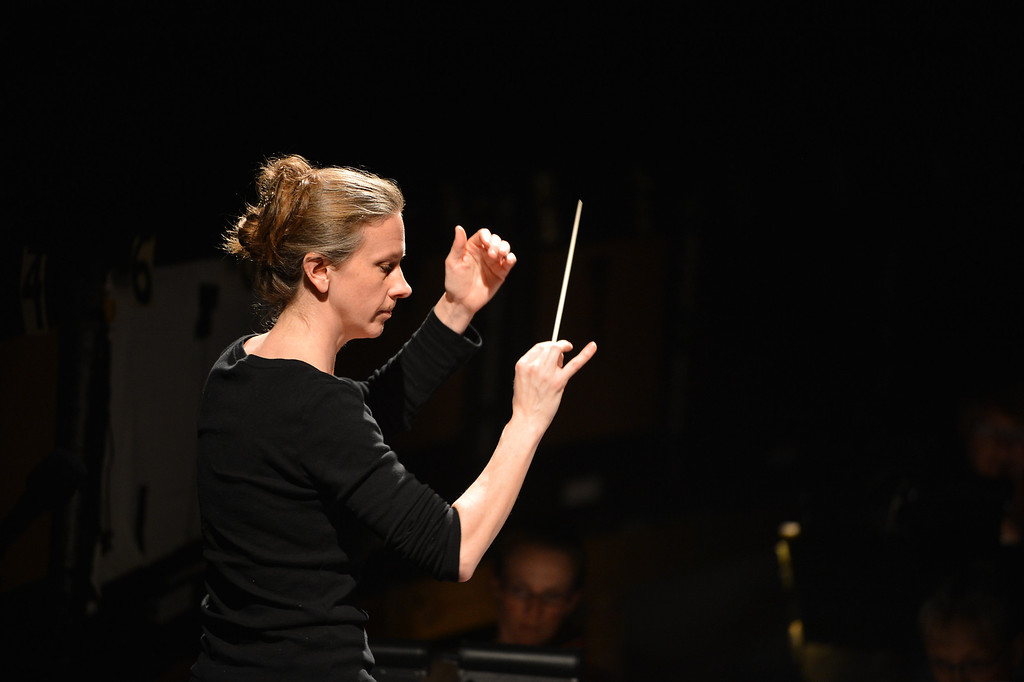 ". Sara Jobin conducts the orchestra during a rehearsal for a collaborative production of ""The Secret Garden\"" by Cal Performances and S.F. Opera at Zellerbach Hall on the University of California campus in Berkeley, Calif. on Wednesday, Feb. 27, 2013. (Kristopher Skinner/Staff)"