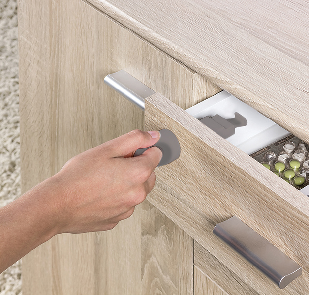 Fred_Home_Safety_Invisible_Magnet_Lock_Lifestyle_grey_close_up.jpg