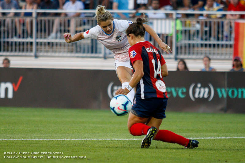 Houston Dash forward Kealia Ohai (7) shoots the ball past Washington Spirit defender Paige Nielsen (14) at Maureen Hendricks Field in Boyds, MD, on July 20, 2019.