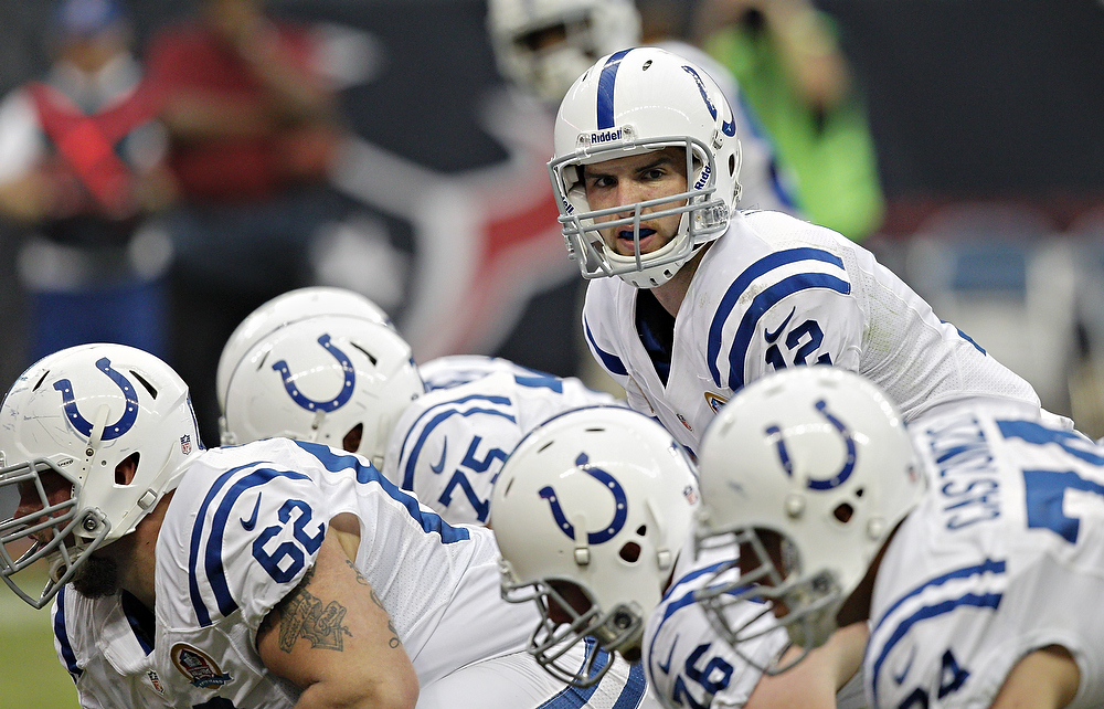 . Andrew Luck #12 of the Indianapolis Colts calls out the play at the line of scrimmage against the Houston Texans in the first half at Reliant Stadium on December 16, 2012 in Houston, Texas.  (Photo by Bob Levey/Getty Images)
