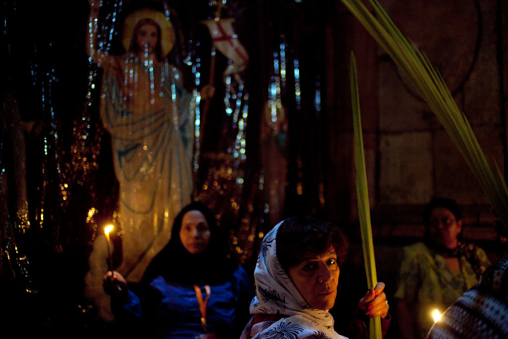 . Orthodox Christian worshipers hold palm fronds in the Church of the Holy Sepulchre, traditionally believed by many to be the site of the crucifixion and burial of Jesus Christ, during Palm Sunday services in Jerusalem\'s Old city, Sunday, April 28, 2013. Palm Sunday marks for Christians, Jesus Christ\'s entrance into Jerusalem, when his followers laid palm branches in his path, prior to his crucifixion. (AP Photo/Ariel Schalit)
