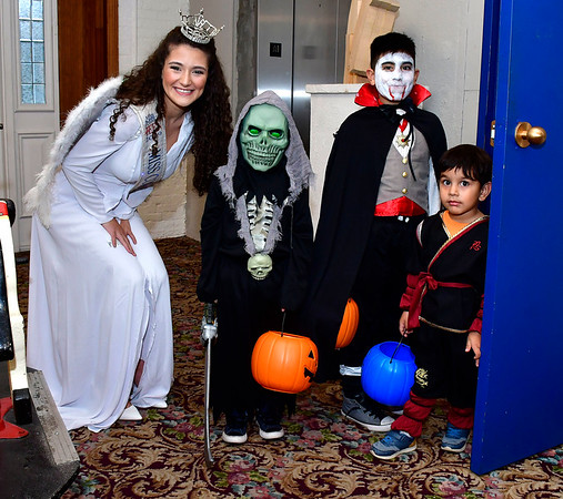 10/31/2019 Mike Orazzi | StaffrMiss Connecticut's Outstanding Teen Linda Frangu with brothers Leon, Dillion and Genaro Gonzalez during Halloween activities at the New England Carousel Museum on Thursday.