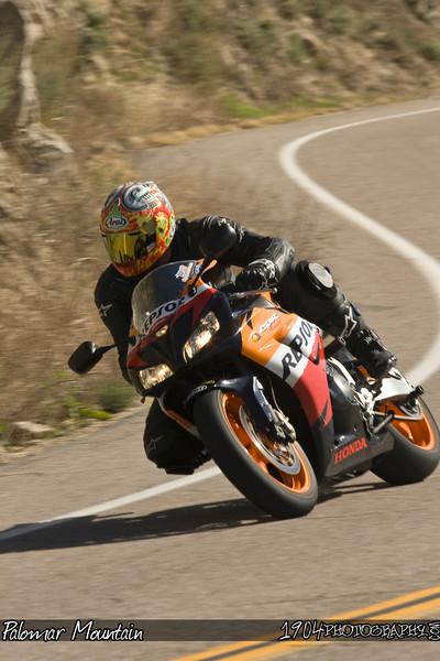A Honda Repsol replica CBR motorcycle heads up Palomar Mountain on South Grade Road