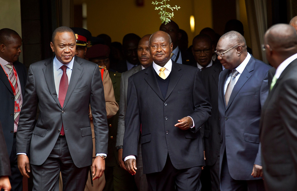 . Kenya\'s President Uhuru Kenyatta, left, Uganda\'s President Yoweri Museveni, center, and the transitional leader of the Central African Republic Michel Djotodia, right, arrive for the Special Summit of the International Conference on the Great Lakes Region (ICGLR) held at the United Nations Office in Nairobi, Kenya on July 31, 2013. Uganda\'s President Museveni signed a controversial anti-gay bill that allows harsh penalties for homosexual offenses, a bill which rights groups have condemned as draconian in a country where homosexuality is already illegal on Monday, Feb. 24, 2014. (AP Photo/Ben Curtis, File)