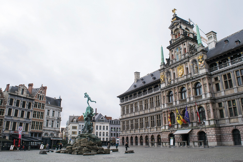 an european square with a statue in the middle of the street as seen on an Antwerp walking tour.