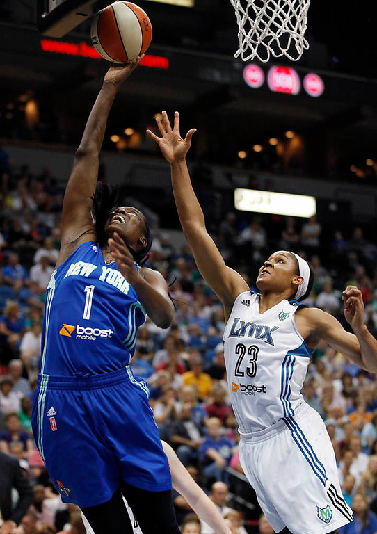 . New York Liberty forward DeLisha Milton-Jones  goes up to the basket against Minnesota Lynx forward Maya Moore  in the first half. (AP Photo/Stacy Bengs)