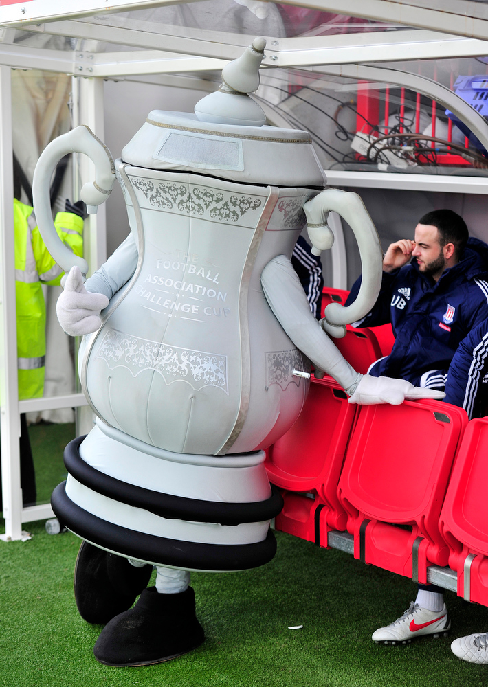 Description of . The FA Cup mascot stands before Crawley Town's FA Cup fifth round football match against Stoke City at Broadfield Stadium in Crawley, England on February 19, 2012. AFP PHOTO/GLYN KIRK