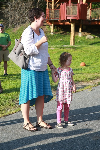 B20A6110_Adrienne McFarland, with her daughter Isadora McFarland, cheering on older daughter Astrid, who was starting second grade at WES.jpg