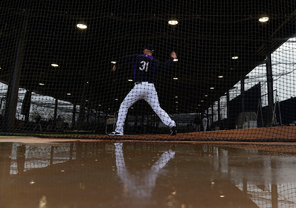 . SCOTTSDALE, AZ. - FEBRUARY 20: Chris Volstad of the Colorado Rockies warms up in the batting cages where players spent the morning  due to rain during Spring Training  February 20, 2013 in Scottsdale. (Photo By John Leyba/The Denver Post)