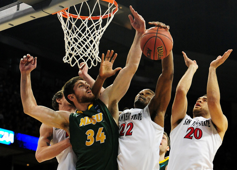 . Chris Kading #34 of the North Dakota State Bison tries to rebound against Josh Davis #22 and JJ O\'Brien #20 of the San Diego State Aztecs in the first half during the Third Round of the 2014 NCAA Basketball Tournament at Spokane Veterans Memorial Arena on March 22, 2014 in Spokane, Washington.  (Photo by Steve Dykes/Getty Images)