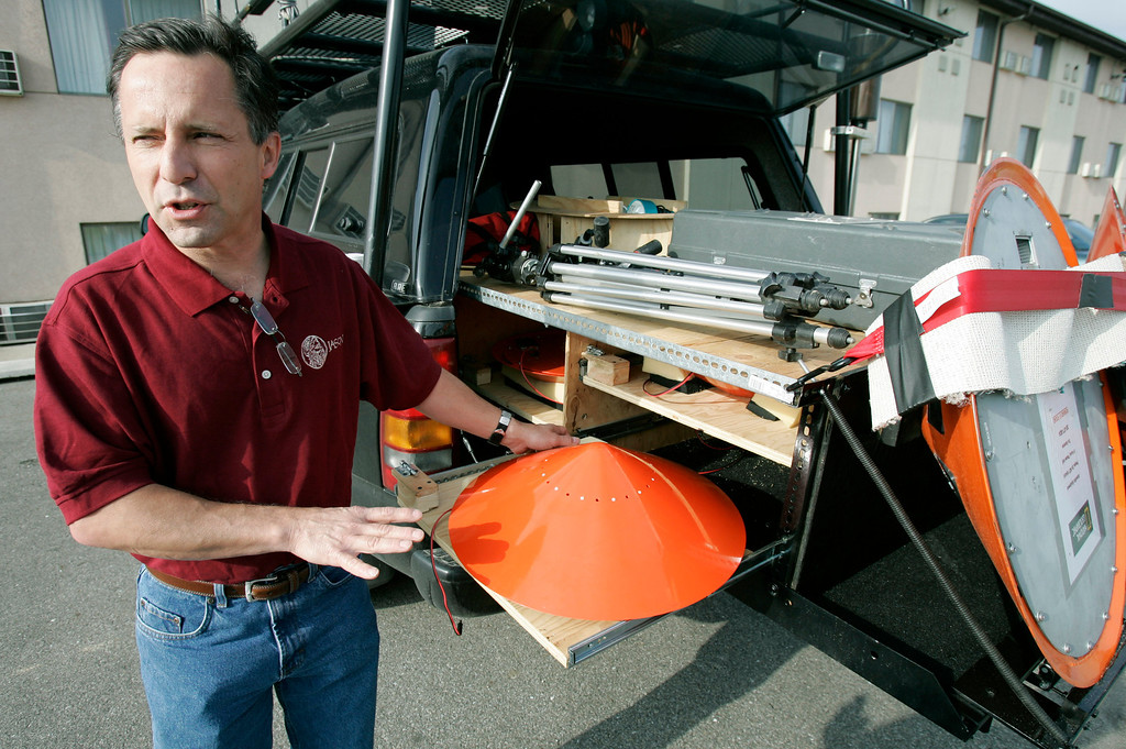 . In this May 26, 2006, file photo Tornado chaser Tim Samaras shows the probes he uses when trying to collect data in Ames, Iowa. Jim Samaras said Sunday, June 2, 2013, that his brother Tim Samaras was killed along with Timís son, Paul Samaras, and another chaser, Carl Young,  on Friday, May 31, 2013 in Oklahoma City. The National Weather Serviceís Storm Prediction Center in Norman, Okla., said the men were involved in tornado research. (AP Photo/Charlie Neibergall, File)