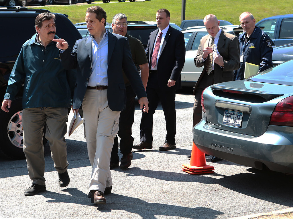 . Gov. Andrew Cuomo, second right, speaks with Acting State Department of Corrections and Community Supervision Commissioner Anthony Annucci as he arrives for a news conference in Dannemora, N.Y. on Saturday, June 6, 2015 during a search for escaped prisoners. Two convicted murderers used power tools to cut through steel pipes at a maximum-security prison near the Canadian border and escape through a manhole, Cuomo said Saturday. (Gabe Dickens/Press-Republican via AP)