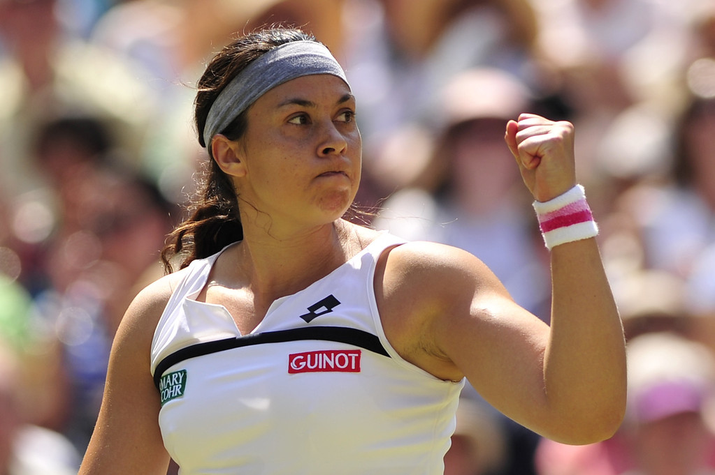 . France\'s Marion Bartoli reacts after winning a point during a game in the first set against Germany\'s Sabine Lisicki in their women\'s singles final match on day twelve of the 2013 Wimbledon Championships tennis tournament at the All England Club in Wimbledon, southwest London, on July 6, 2013.   GLYN KIRK/AFP/Getty Images