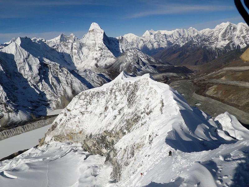 Nice view from Island Peak (20,305ft = 6.189m) towards Island Peak ridge and Ama Dablam (22,493ft = 6.856m).