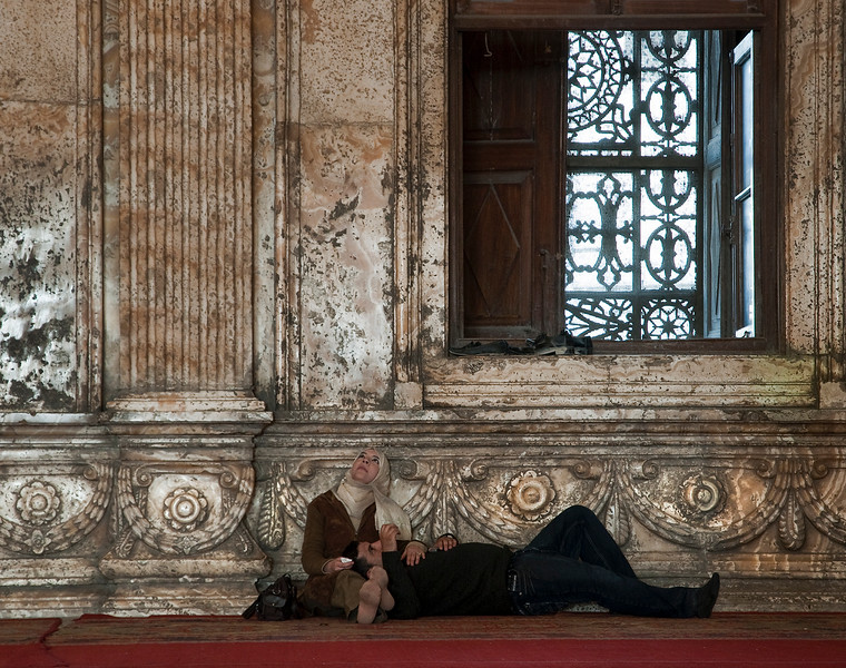 Couple relaxing inside the Mohammed Ali Mosque.  Cairo, Egypt, 2010.