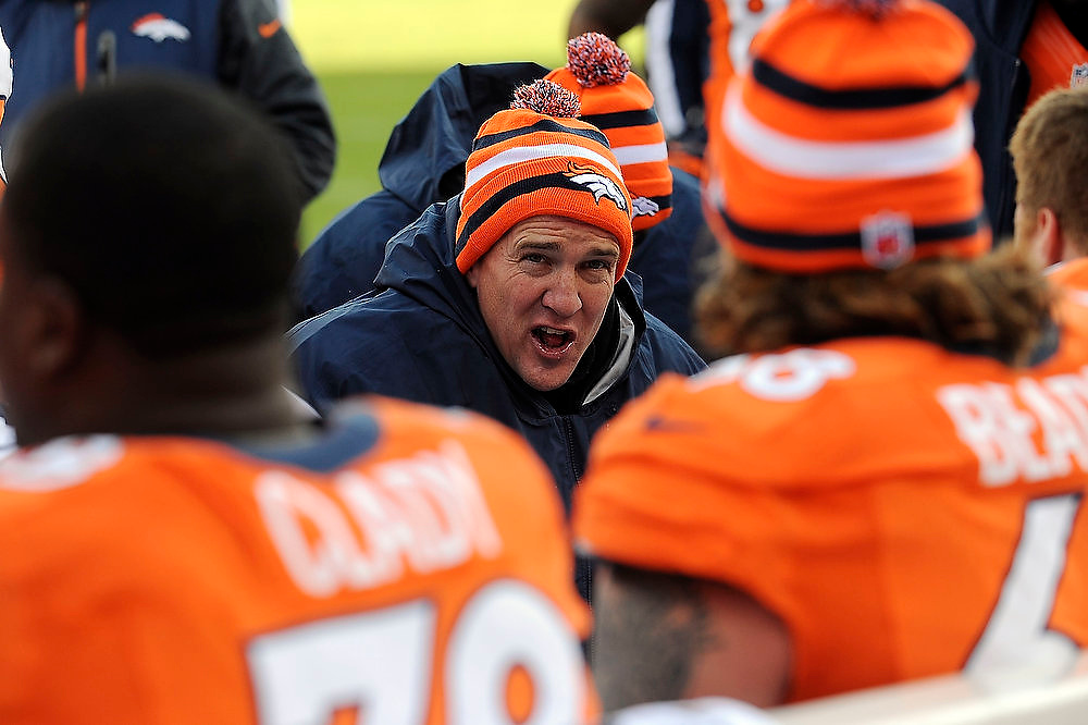 Description of . Denver Broncos quarterback Peyton Manning talking to the offensive line after the scored a touchdown on thier first posession against Kansas City Sunday at Sports Authority Field. Steve Nehf, The Denver Post