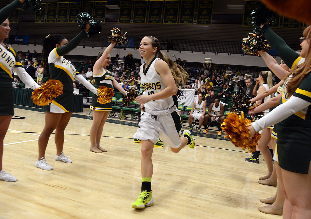 . Cal Poly Pomona\'s Ariel Marsh runs out onto the court before the game against Montana State Billings during the NCAA Division II West Regional championship game at Cal Poly Pomona in Pomona, CA, Monday, March 17, 2014. (Photo by Jennifer Cappuccio Maher/Inland Valley Daily Bulletin)
