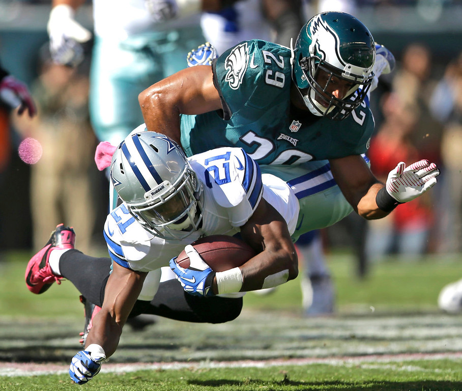 . Dallas Cowboys running back Joseph Randle (21) is brought down by Philadelphia Eagles strong safety Nate Allen (29) during the first half of an NFL football game, Sunday, Oct. 20, 2013, in Philadelphia. (AP Photo/Matt Rourke)