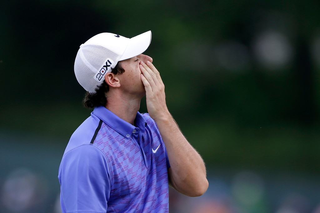 . Rory McIlroy, of Northern Ireland, reacts after putting on the 15th green during the third round of the U.S. Open golf tournament at Merion Golf Club, Saturday, June 15, 2013, in Ardmore, Pa. (AP Photo/Darron Cummings)