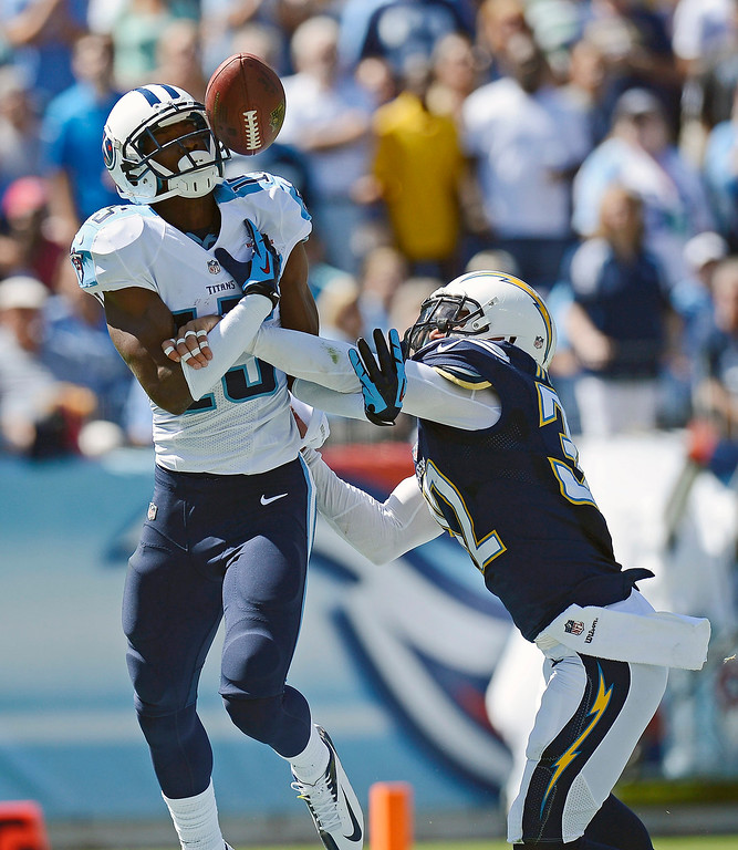 . Tennessee Titans wide receiver Justin Hunter (15) can\'t hang onto a pass as he is defended by San Diego Chargers free safety Eric Weddle (32) in the second quarter of an NFL football game on Sunday, Sept. 22, 2013, in Nashville, Tenn. (AP Photo/Mark Zaleski)