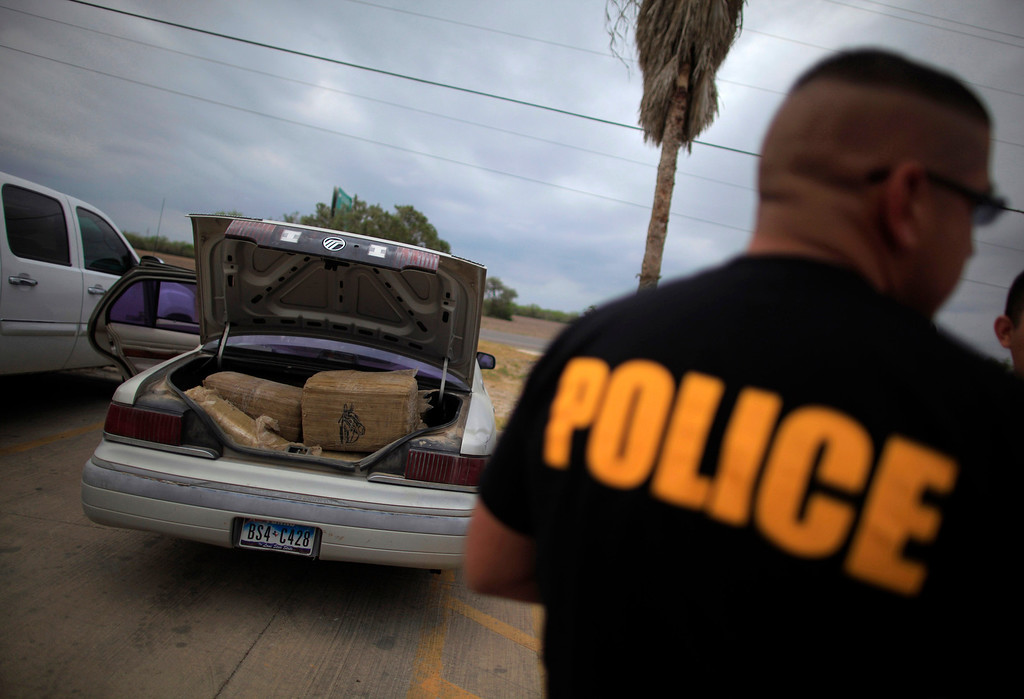 ". A car filled with bales of marijuana is seen at a police station in La Grulla, Texas March 28, 2013. When police tried to pull the car over, the driver led officers on a high speed pursuit, driving the car into the Rio Grande river. The driver abandoned the vehicle and fled back across the river and into Mexico. Brooks County has become an epicentre for illegal immigrant deaths in Texas. In 2012, sheriff\'s deputies found 129 bodies there, six times the number recorded in 2010. Most of those who died succumbed to the punishing heat and rough terrain that comprise the ranch lands of south Texas. Many migrants spend a few days in a ""stash house\"", such as the Casa del Migrante, in Reynosa, Mexico, and many are ignorant of the treacherous journey ahead. Border Patrol agents and local and state law enforcement are inundated with not only an increase in the numbers of illegal immigrants, but drug smugglers as well. Picture taken March 28, 2013. REUTERS/Eric Thayer"