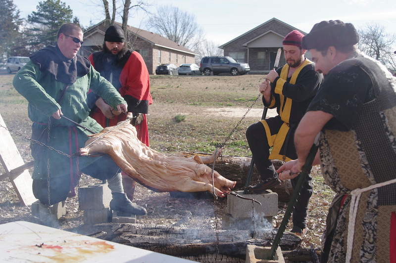 Trussing up the Pig for feast.