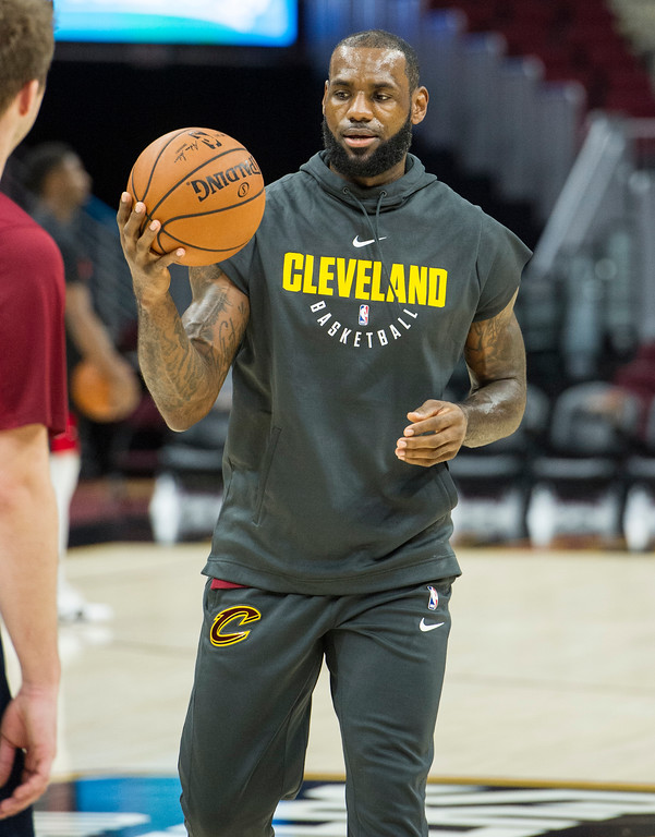 . Cleveland Cavaliers\' LeBron James warms up before playing an NBA preseason basketball game against the Chicago Bulls in Cleveland, Tuesday, Oct. 10, 2017. (AP Photo/Phil Long)
