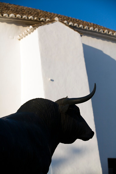 Fighting bull sculpture in front of the 18th century bullring, town of Ronda, province of Malaga, Andalusia, Spain