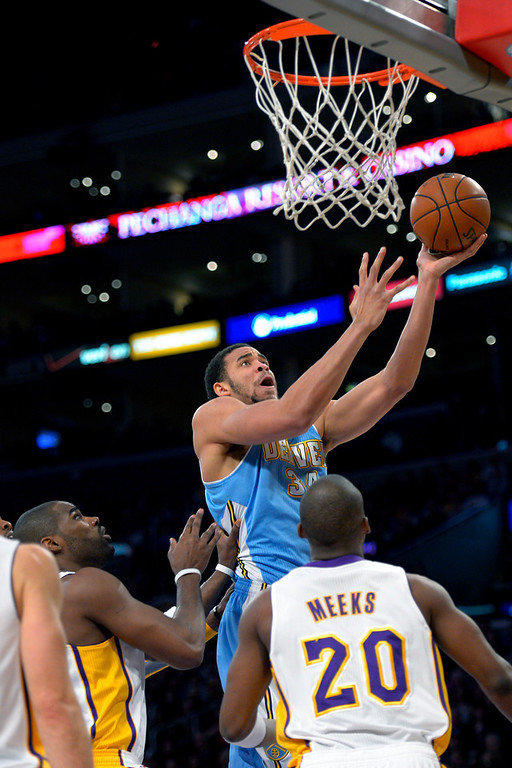 . Denver Nuggets center JaVale McGee (34) goes to the basket over Los Angeles Lakers\' Jodie Meeks during the first half of their NBA basketball game, Sunday, Jan. 6, 2013, in Los Angeles. (AP Photo/Mark J. Terrill)