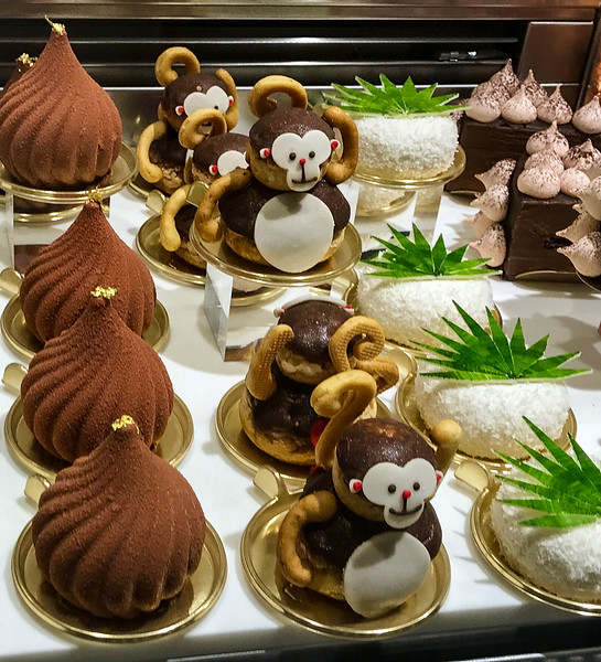 Chocolate pastries, Monkey cakes and coconut cakes in a Tokyo food hall display window.