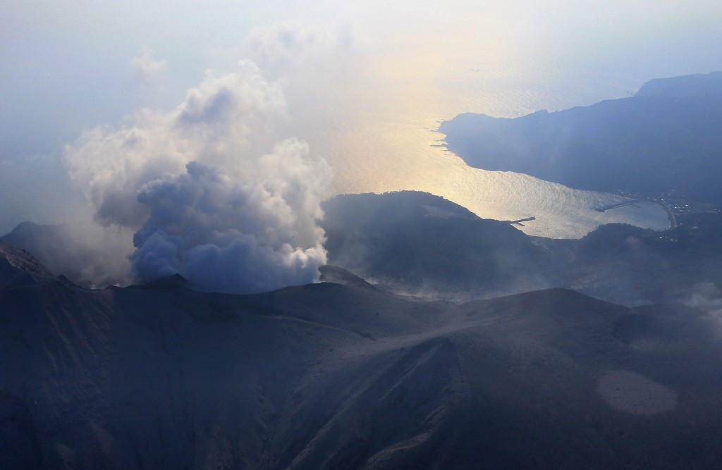 . An aerial view taken on May 29, 2015 shows smoke rising from Mount Shindake on Kuchinoerabu island in Kagoshima prefecture of Japan\'s southern island of Kyushu. A violent volcanic eruption in southern Japan forced the evacuation of an island, as a huge column of ash was shot high into the sky.    AFP PHOTO / JIJI  PRESS/AFP/Getty Images