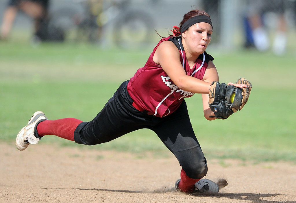 . Barstow shortstop Aleesha Rodriguez dives for the catch on a line drive by Northview\'s Reyanne Gonzales (not pictured) in the fifth inning of a CIF-SS quarterfinal playoff softball game at Northview High School on Thursday, May 23, 2013 in Covina, Calif. Northview won 5-4.  (Keith Birmingham Pasadena Star-News)
