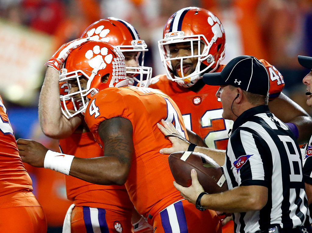 . Clemson quarterback Deshaun Watson (4) celebrates his touchdown run with teammates against Ohio State during the first half of the Fiesta Bowl NCAA college football playoff semifinal, Saturday, Dec. 31, 2016, in Glendale, Ariz. (AP Photo/Ross D. Franklin)